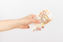 Fifty euro in the woman`s hand, light background Stock Image