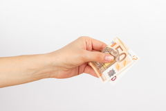 Fifty euro in the woman`s hand, light background Stock Photo