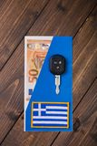 Fifty euros banknote and car keys. On wooden background stock photography