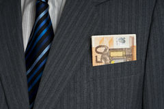 Fifty euros in pocket. Fifty euros banknotes in business man gray suit pocket Royalty Free Stock Photography