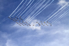 Fifty flying airplanes flyover Stock Photo