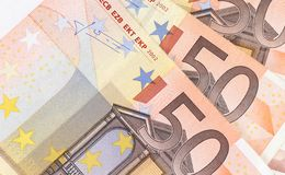Fifty hundred euro banknotes in a row. Royalty Free Stock Photo