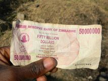 Fifty million  Zimbabwean dollar  note. Harare,A hand  holding  a  fifty  million  Zimbabwean dollar note/bill  which  was  used during  the  days  of  hyper Royalty Free Stock Images