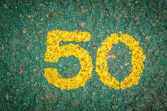 Fifty Number on Green cement Royalty Free Stock Photos
