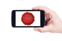 50 or fifty off discount price concept on smartphone Royalty Free Stock Image