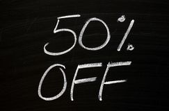 Fifty Per Cent Off on a Blackboard stock photography