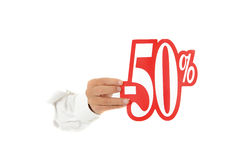 Fifty percent discount sign, hand. Hand of man breaking through a paper wall showing fifty percent discount sign. Copy space. Studio shot. White background Stock Photography
