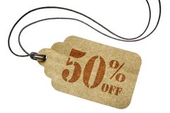 Fifty percent off discount -  paper price tag. Fifty  percent off discount  - a paper price tag with twine isolated on white Stock Photos