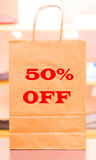 Fifty percent off. A sale in clothing store giving you 50 percent off on all of their items Royalty Free Stock Images