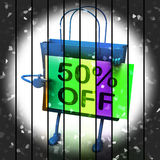 Fifty Percent Reduced On Bags Shows 50 Bargains. Fifty Percent Reduced On Bags Show 50 Bargains Royalty Free Stock Photo