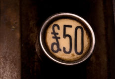 Fifty pound button. On old cash register Royalty Free Stock Image