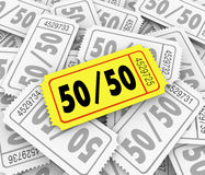 50-Fifty Raffle Tickets Pile Fundraiser Charity Contest Winner. 50-Fifty word and numbers on a golden raffle ticket in a pile to illustrate drawing for a Royalty Free Stock Photos