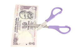 Fifty Rupee banknotes with scissors (Indian currency) Royalty Free Stock Photo