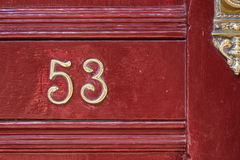 Fifty Three. Number fifty three in a red door Stock Images