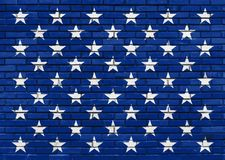 Fifty White Stars on the painted blue brick wall, American Flag theme Royalty Free Stock Images