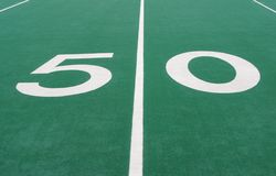 Fifty Yard Line. Closeup of the Fifty Yard Line Marker for a Football Field royalty free stock images