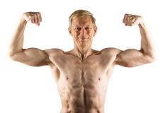 Fifty-year-old man shows front double bicep Royalty Free Stock Image
