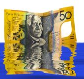 FiftyFlood. Australian fifty dollar note on white background and flood reflection Royalty Free Stock Photos