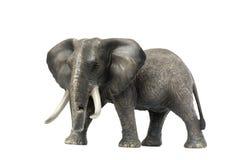Figürchen eines Elefanten auf einem weißen Hintergrund spielzeug Weicher Fokus Lizenzfreie Stockbilder