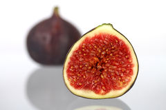 Fig. Two figs on light background with reflection Royalty Free Stock Images