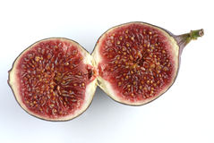 Fig. A divided fig on a white background Stock Photos