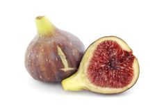 Fig cut. Fig whole and cut on a white background Stock Images
