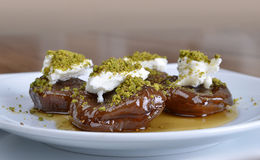 Fig dessert. Dried figs dessert with clotted cream of milk and pistacchio Stock Images