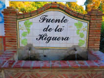 The Fig Fountain. Hand painted Ceramic tiles depicting name of local drinking water fountain near Alora, Andalucia Royalty Free Stock Images
