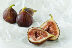 Fig fruits. On a white paper Stock Photos
