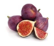 Fig fruits with half isolated on white background.  royalty free stock photography