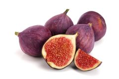 Fig fruits with half isolated on white background.  stock image