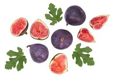 Fig fruits with leaves isolated on white background. Top view. Flat lay pattern stock images