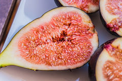Fig fruits on the plate. Close-up shot of fig fruits lying on the plate Royalty Free Stock Photography