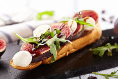 Fig and Goat Cheese Bruschetta. With Rocket Salad royalty free stock photo