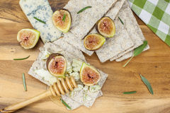 Fig and gorgonzola crostini with honey Stock Image