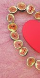 The fig heart and a red box Stock Photo
