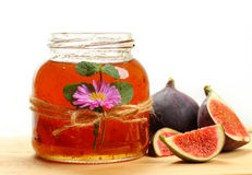 Fig jam. Jar of homemade fig jam and fresh fruits Royalty Free Stock Photo