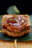 Fig jam on bread slices Stock Photos