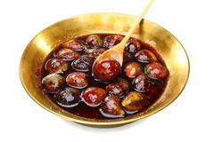 Fig jam in the copper basin. Royalty Free Stock Image
