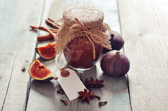 Fig jam. In a glass jar with  fresh figs on wooden background Royalty Free Stock Photo