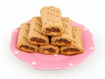 Fig jam rolls on a pink plate Stock Photography