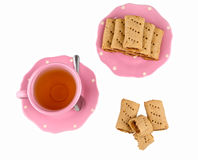 Fig jam rolls with tea cup Stock Photo