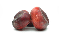 Fig a peach on a white background Stock Photos