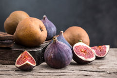 Fig and pear. On a wooden board Stock Photography