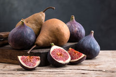 Fig and pear. On a wooden board Royalty Free Stock Photo