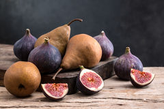 Fig and pear. On a wooden board Stock Photos