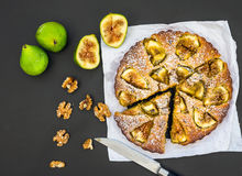 Fig pie with fresh figs and walnuts on black Royalty Free Stock Photo