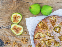 Fig pie with fresh figs and walnuts over a wood background Stock Image