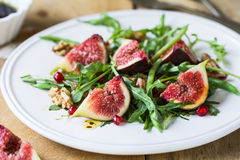 Fig with Pomegranate and rocket salad Royalty Free Stock Photo