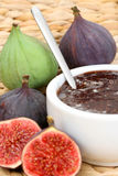 Fig preserved. Bowl of fig preserved and sme fresh figs Royalty Free Stock Image